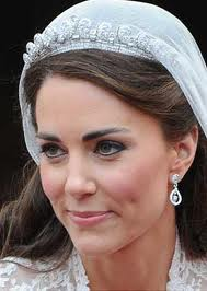 The new Duchess of Cambridge wearing the Cartier Halo Tiara and matching earrings from Robinson Pelham