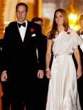 Duke and Duchess of Cambridge wear their poppies at black tie event