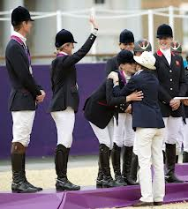 Zara receiving her silver Olympic medal from Princess Anne