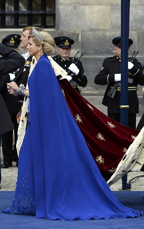 Dutch King Willem-Alexander and his wife Queen Maxima leave Nieuwe Kerk church after the religious crowning ceremony in Amsterdam