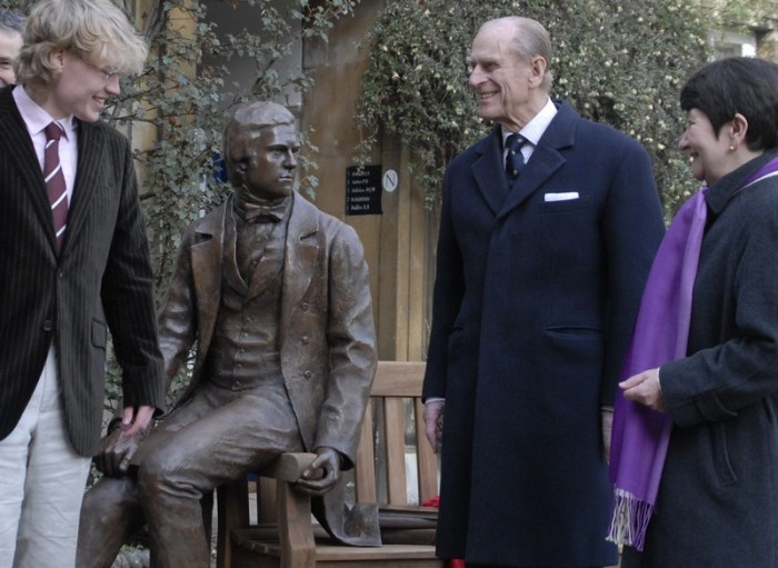 Prince Philips with a statue of Charles Darwin
