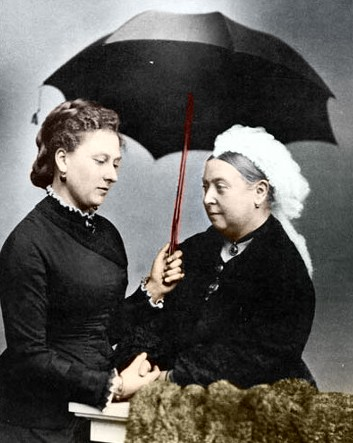 A Photograph of Beatrice & Victoria inexplicably under an umbrella (via Wikipedia)