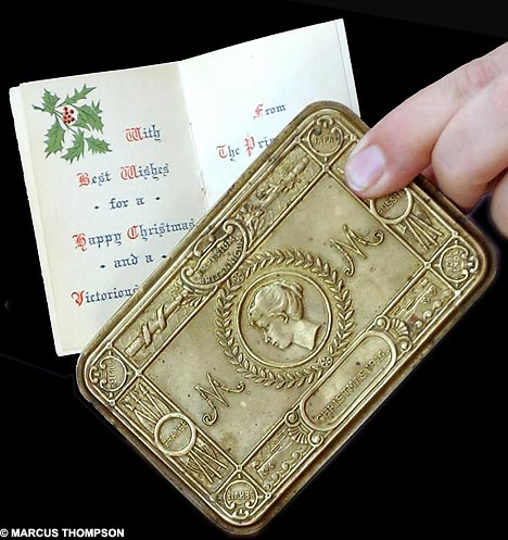 A Christmas card sent to troops from King George along with a gift box from Princess Mary (via Daily Mail)