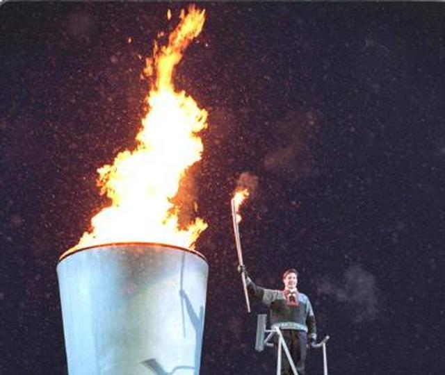 Prince Haakon lights the flame at the opening ceremony of the Lillehamer Olympics