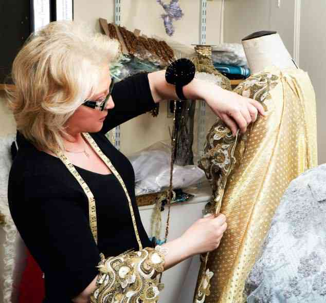 Angela Kelly at work on the Queen's dress for the Jubilee Concert (Via The Daily Mail)
