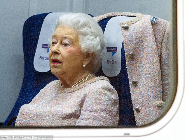 The Queen got comfortable on the train. Check out the aquamarine brooch on her tweed jacket (source)