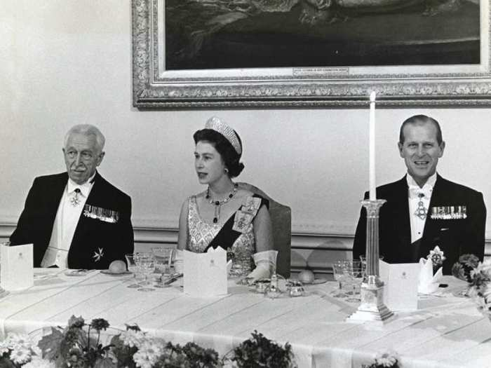 The Queen and Prince Philip at dinner during a visit to Rideau Hall, Ottawa in 1964 (source)